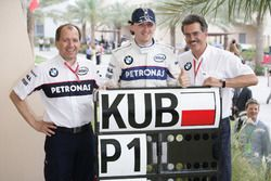 Willy Rampf, Technical Director, BMW Sauber, Robert Kubica, BMW Sauber, and Mario Theissen, Director, BMW Motorsport, celebrate their first pole position