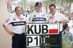 Willy Rampf, technisch directeur BMW Sauber, Robert Kubica, BMW Sauber, en Mario Theissen, Directeur