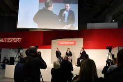 Billy Monger and stunt driver Terry Grant talk to Henry Hope-Frost on the Autosport Stage