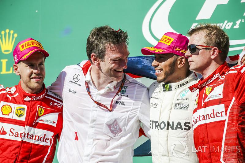 Race winner Lewis Hamilton, Mercedes AMG F1 celebrates on the podium alongside James Allison, Merced