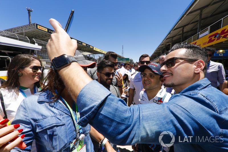 Felipe Massa, Williams, has his picture taken with a fan