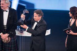 Nelson Piquet collects his Gregor Grant Award on stage, with Gordon Murray