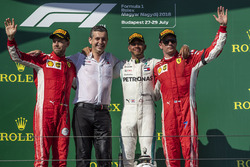 Sebastian Vettel, Ferrari, Lewis Hamilton, Mercedes-AMG F1 and Kimi Raikkonen, Ferrari celebrate on the podium