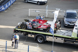 Remains of #37 Jackie Chan DC Racing Oreca 07 Gibson: Jazeman Jaafar, Weiron Tan, Nabil Jeffri, returning to the pits