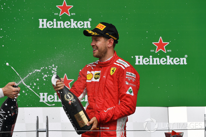 Sebastian Vettel, Ferrari celebrates on the podium with the cahmpagne