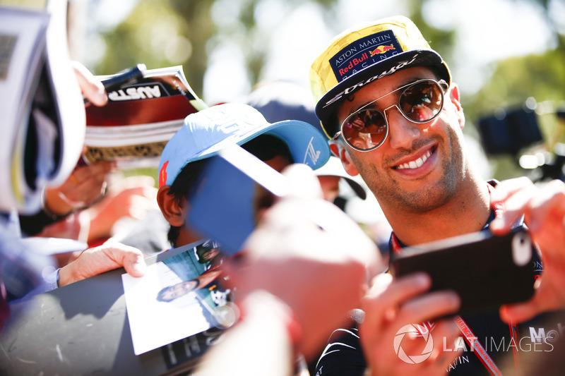 Daniel Ricciardo, Red Bull Racing, takes a photo of himself with a fan