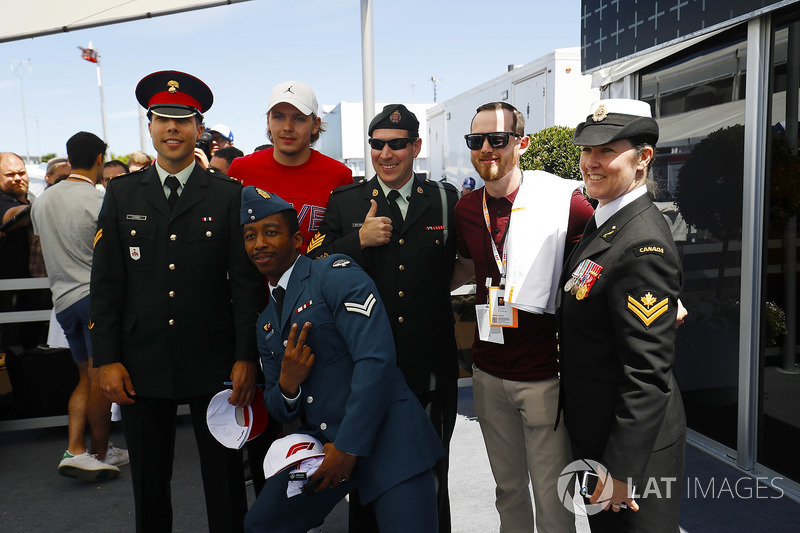 Members of the Canadian military meet hockey players Hampus Lindholm of Anaheim Ducks, and Pauleads
