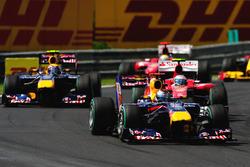 Sebastian Vettel, Red Bull Racing RB6 leads Fernando Alonso, Ferrari F10 and Mark Webber, Red Bull Racing RB6