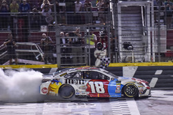 Kyle Busch, Joe Gibbs Racing, Toyota Camry M&M's Red White & Blue, does a burnout after winning