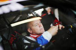 Un pilota al volante della sua Porsche 911 GT3