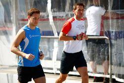 Stoffel Vandoorne, McLaren, jogs in the pit lane with his trainer