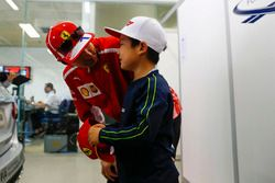 Kimi Raikkonen, Ferrari, meets a young fan