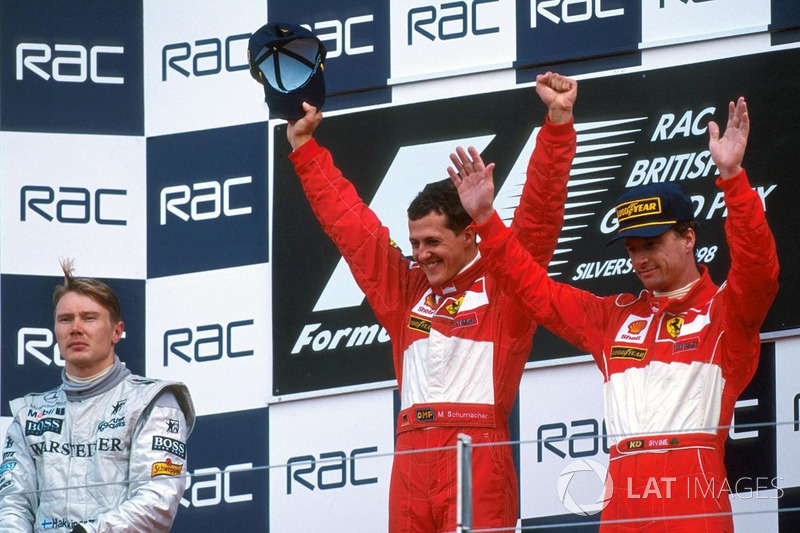 Podium: race winner Michael Schumacher, Ferrari, second place Mika Hakkinen, McLaren, third place Eddie Irvine, Ferrari