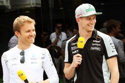 (L to R): Nico Rosberg, Mercedes AMG F1 with Nico Hulkenberg, Sahara Force India F1