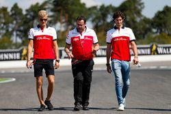 Marcus Ericsson, Sauber, and Antonio Giovinazzi, Sauber, walk the track