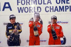 Podium: race winner Alain Prost, McLaren, second place Ayrton Senna, Lotus, Michele Alboreto, Ferrar