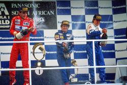 Podium: race winner Alain Prost, second place Ayrton Senna, third place Mark Blundell