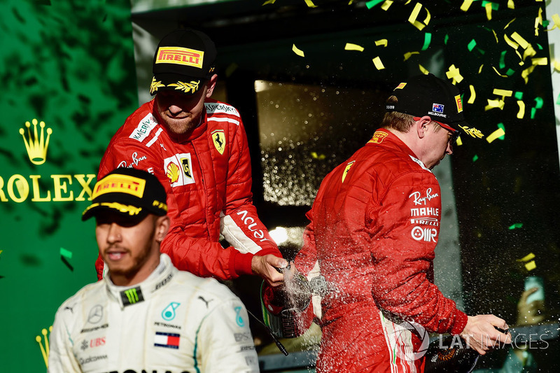 Sebastian Vettel, Ferrari and Kimi Raikkonen, Ferrari celebrate on the podium with the champagne