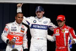 Robert Kubica, BMW Sauber celebrates his first Pole Position with Lewis Hamilton, McLaren and Felipe