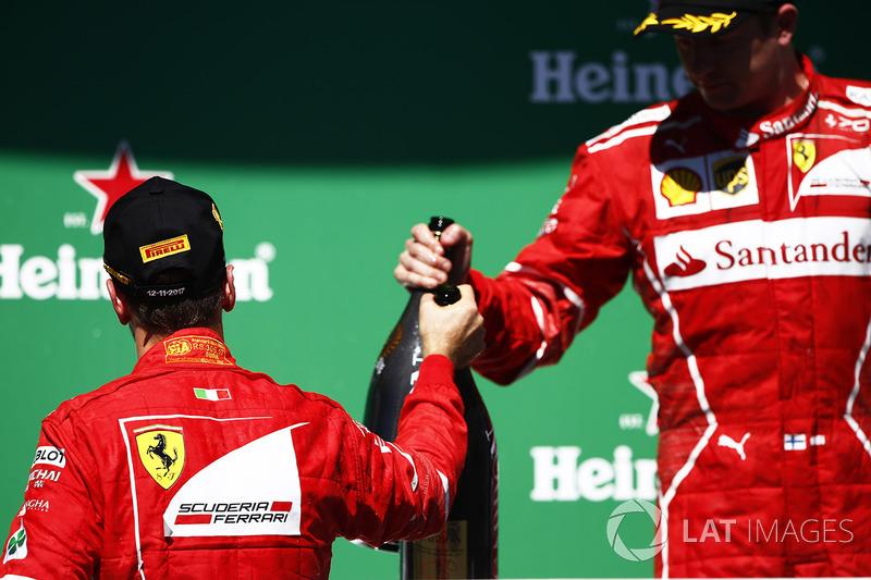 Podium: winner Sebastian Vettel, Ferrari, third place Kimi Raikkonen, Ferrari