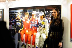 Kelly Piquet stands next to the picture of her dad, Nelson Piquet