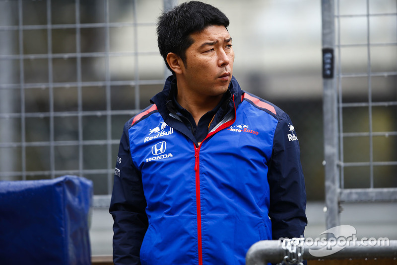 A Honda team member on the pit wall