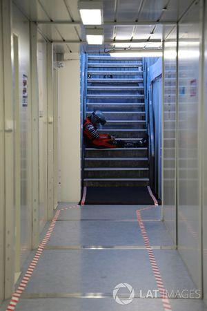 A team member sleeps in the stairway