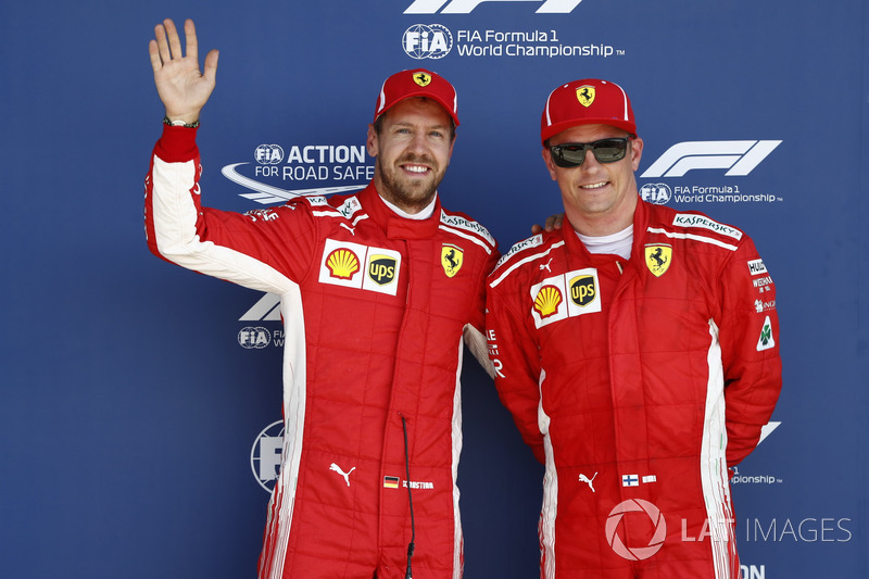 Sebastian Vettel, Ferrari, et Kimi Raikkonen, Ferrari, après les qualifications