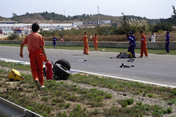 Martin Donnelly, Team Lotus, lies on the track after a horrific crash