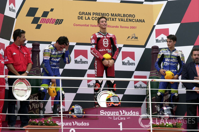 Podium: race winner Manuel Poggiali, second place Toni Elias, third place Dani Pedrosa