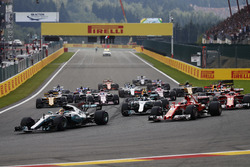 Lewis Hamilton, Mercedes AMG F1 W08, Sebastian Vettel, Ferrari SF70H, lead the pack in to the first corner