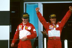 Podium: Race winner Michael Schumacher, Ferrari, third place Eddie Irvine, Ferrari