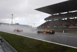 Adrian Sutil, Spyker F8-VII Ferrari, spins directly in the path of his team mate Markus Winkelhock,