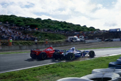 Michael Schumacher, Ferrari F310B turned into Jacques Villeneuve, Williams FW19 Renault at the Curva Dry Sack