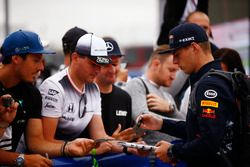 Max Verstappen, Red Bull Racing, signs autoraphs for fans