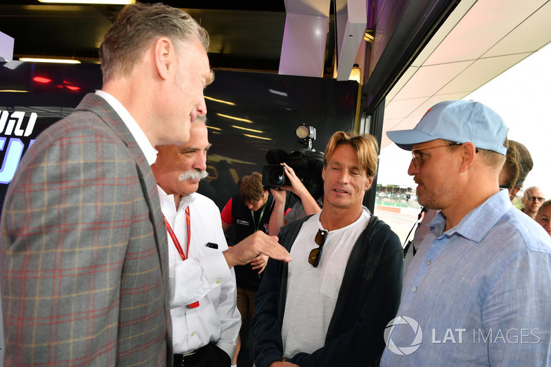 Sean Bratches, Formula One Managing Director, Commercial Operations, Chase Carey, Chief Executive Officer and Executive Chairman of the Formula One Group and Woody Harrelson, Actor