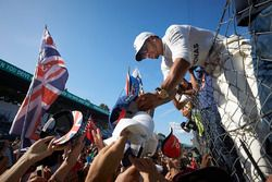 Lewis Hamilton, Mercedes AMG F1, signs autographs for fans