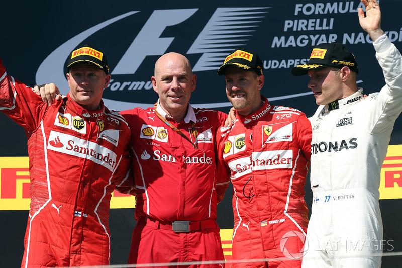 Подіум: переможець гонки Себастьян Феттель, Ferrari, друге місце Кімі Райкконен, Ferrari, третє місц