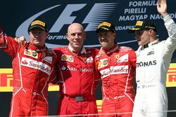 Podium: race winner Sebastian Vettel, Ferrari, second place Kimi Raikkonen, Ferrari, third place Val