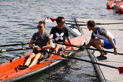 Stoffel Vandoorne, McLaren, Tom Clarkson sit in a boat as Matt Morris, Engineering Director, McLaren