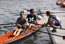 Stoffel Vandoorne, McLaren, Tom Clarkson sit in a boat as Matt Morris, Engineering Director, McLaren, looks on
