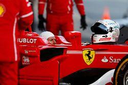 Sebastian Vettel, Ferrari, in cocpkpit wearing balaclava, but with helmet removed
