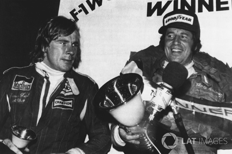 Third place James Hunt, McLaren, world champion Mario Andretti, Lotus