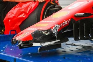 The damaged car of Sebastian Vettel, Ferrari SF1000, on a truck