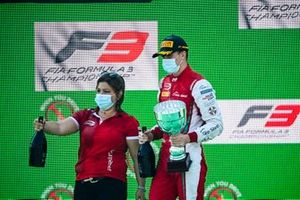 Race Winner Frederik Vesti, Prema Racing celebrates on thr podium with the champagne and the trophy