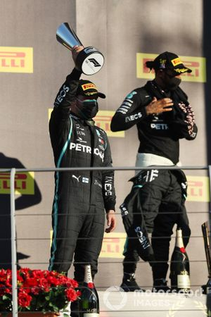 Valtteri Bottas, Mercedes-AMG F1, 2nd position, lifts his trophy alongside Lewis Hamilton, Mercedes-AMG F1, 1st position, on the podium