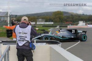 A photographer takes a picture of Esteban Guitiérrez in the 2017 World Championship-winning Mercedes-Benz AMG F1 W08 EQ Power+ Formula 1 car