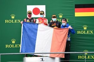 Nikita Mazepin, Hitech Grand Prix, 2nd position, Mick Schumacher, Prema Racing, 3rd position, and Yuki Tsunoda, Carlin, 1st position, with a French flag on the podium in tribute to the late Anthoine Hubert