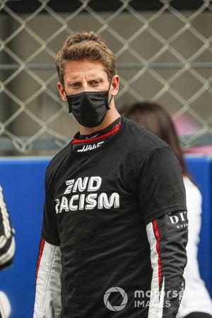 Romain Grosjean, Haas F1, and Kevin Magnussen, Haas F1, on the grid