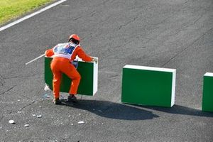 Marshal reassembling the barriers